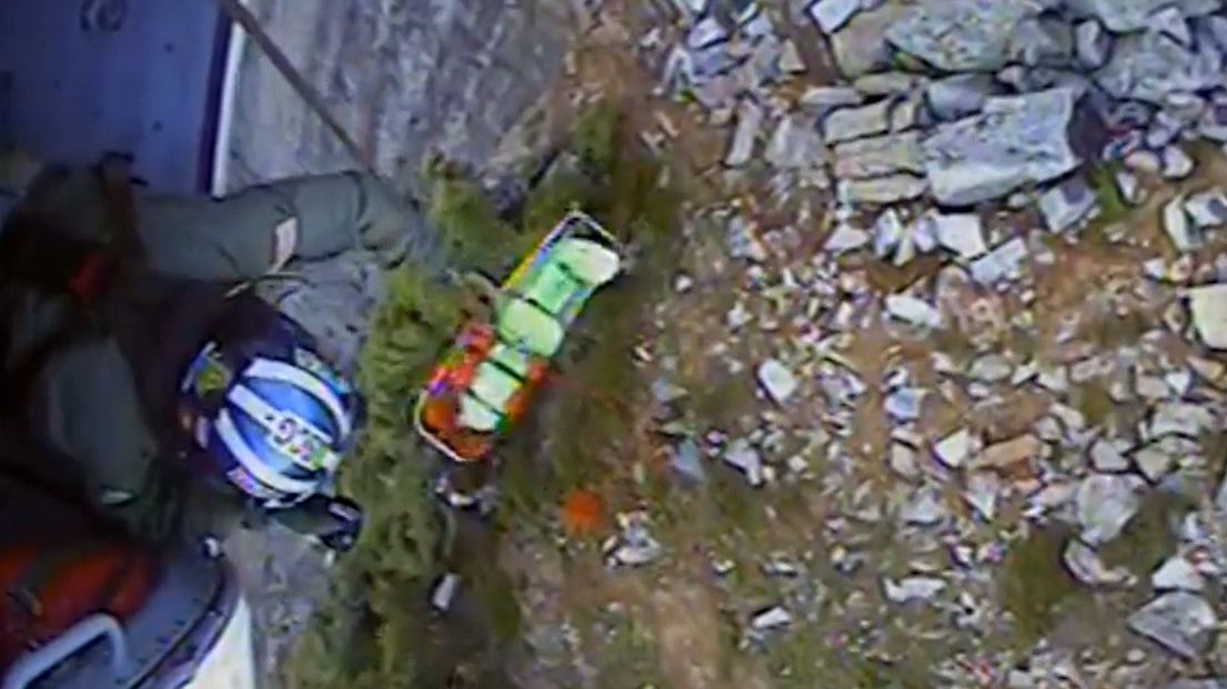 Hiker trapped under boulder