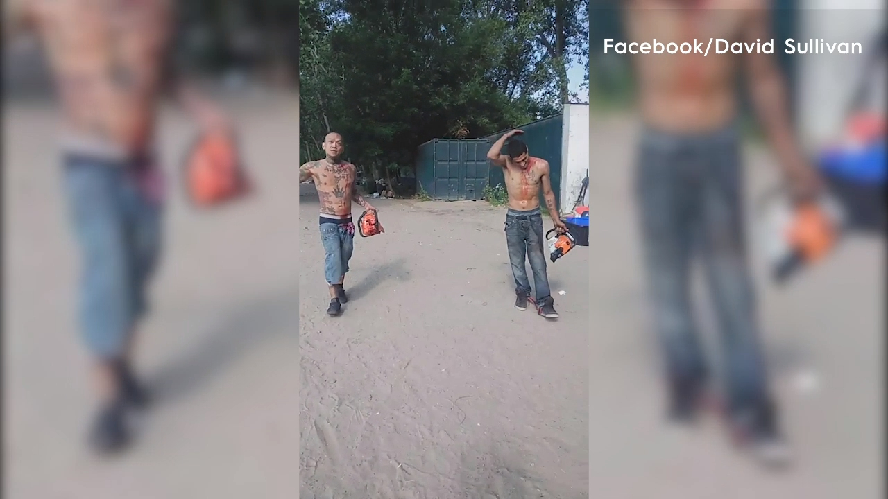Chainsaw-wielding men covered in blood storm Canadian beachgoers