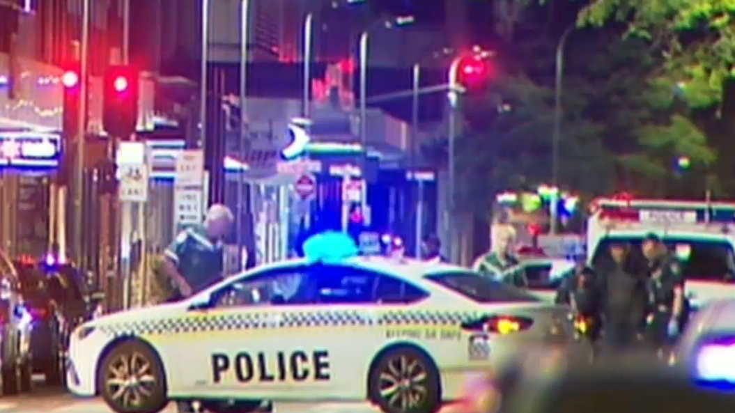 Police lock down Adelaide CBD after alleged shooter threats