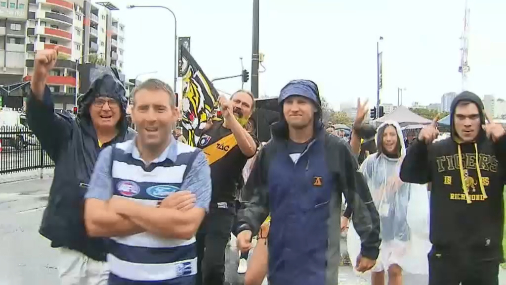 Footy fans prepare ahead of AFL Grand Final at the Gabba
