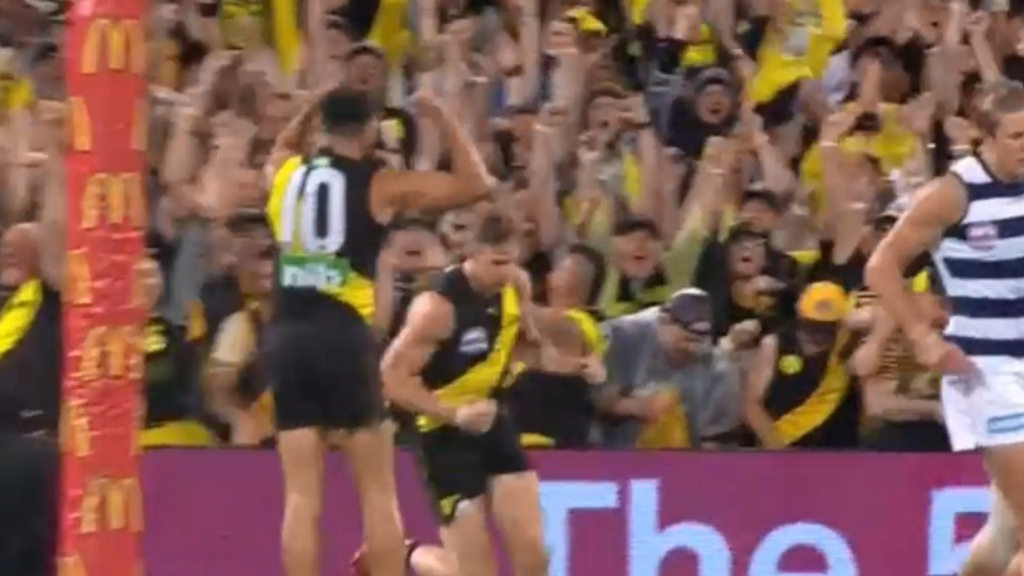 Richmond kick the first goal of the grand final