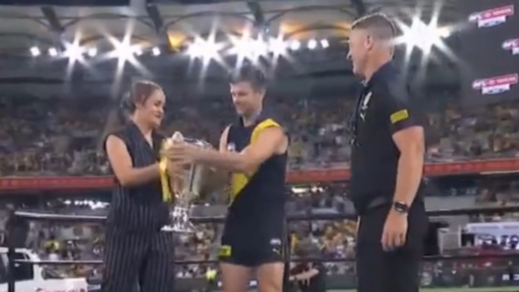 Barty presents Richmond with the Premiership cup