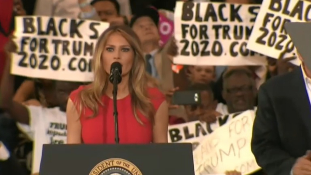 Melania fronts rally alone