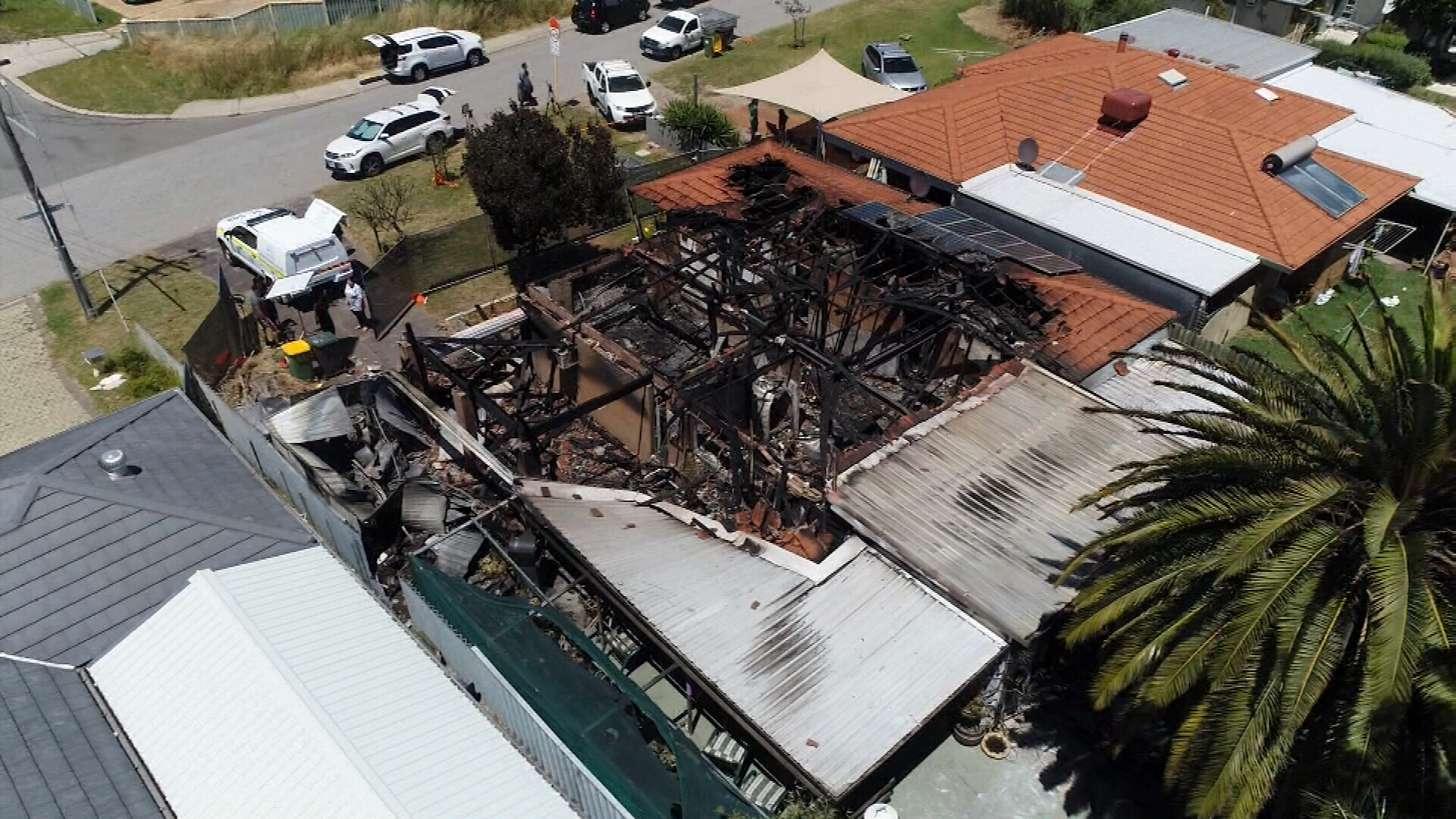 Police officers save Perth grandmother from burning home