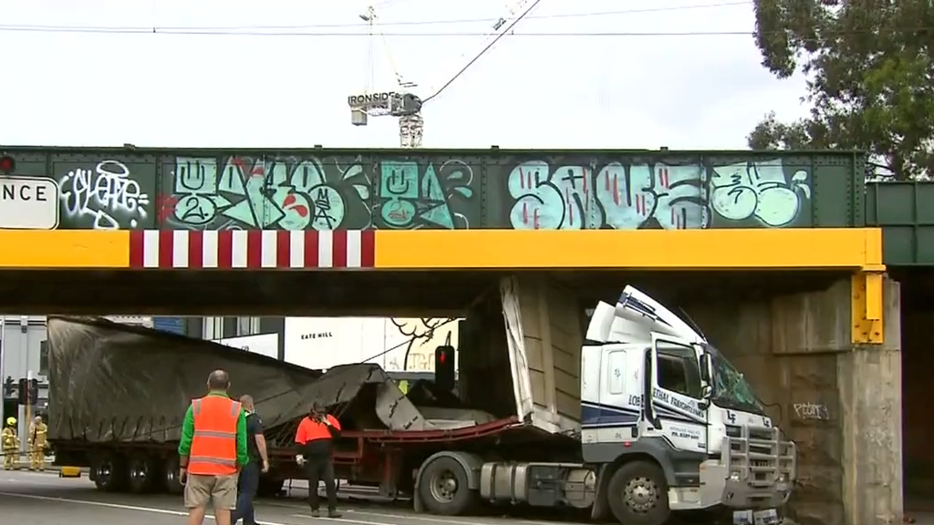 Truck wedged under bridge in south Melbourne