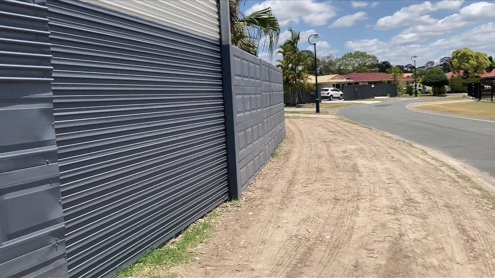 DIY fence built from garage doors divides Gold Coast neighbourhood