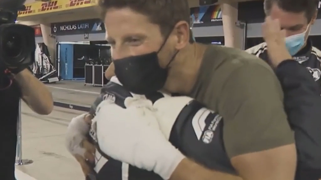 Emotional Grosjean meets workers who saved his life