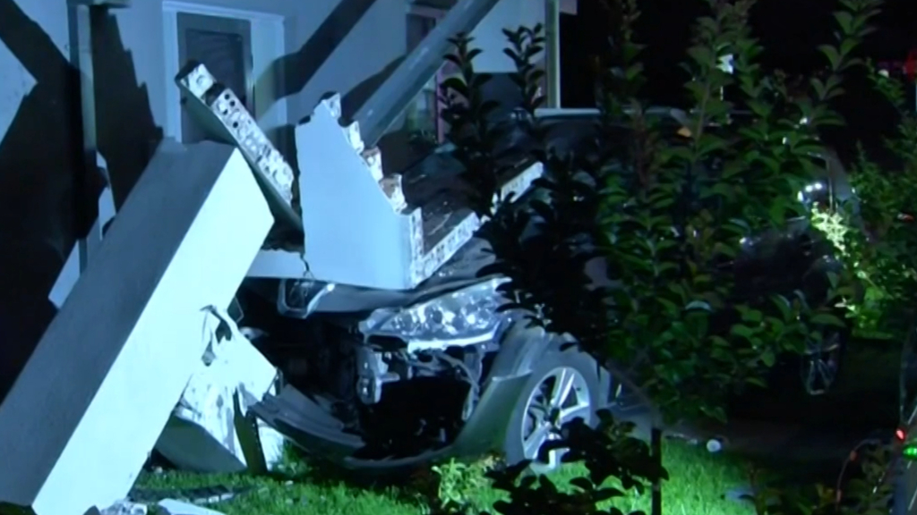 Two people charged after car crashed into Melbourne home