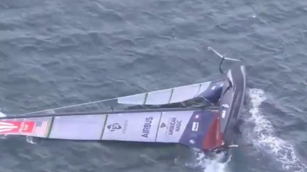 American Magic capsizes