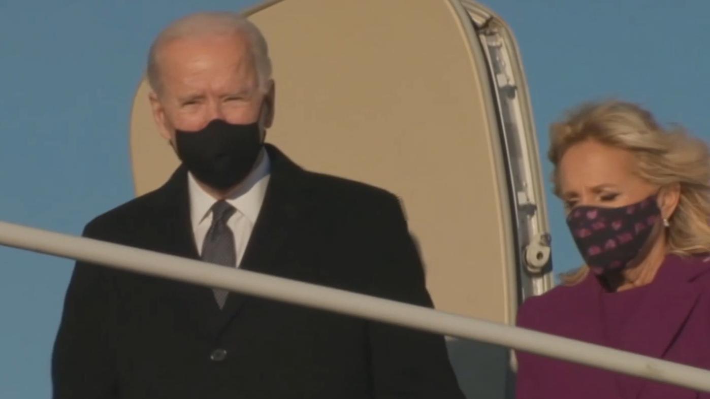 Biden touches down as Trump bids farewell