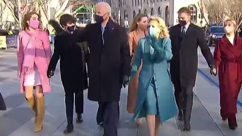 Joe Biden and First Lady walk with presidential escort