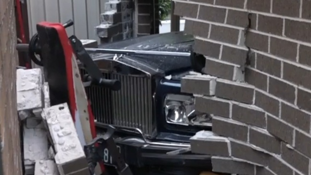 Vintage Rolls Royce crashes into neighbour's home
