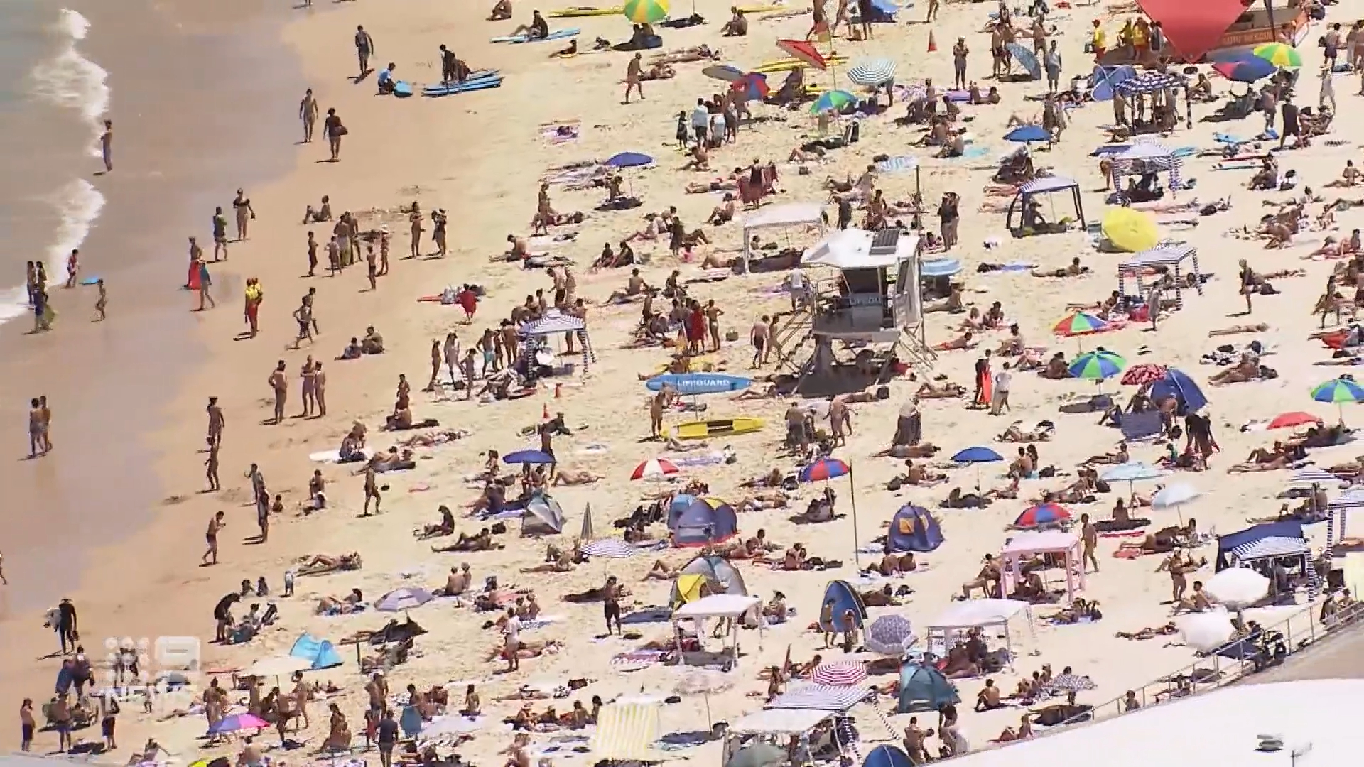 Multiple rescues at Australian beaches as south-east hit by scorching heatwave