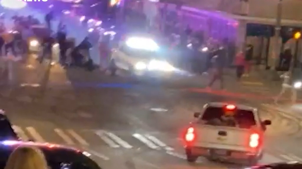 Two hurt as US police car ploughs though crowd at street race