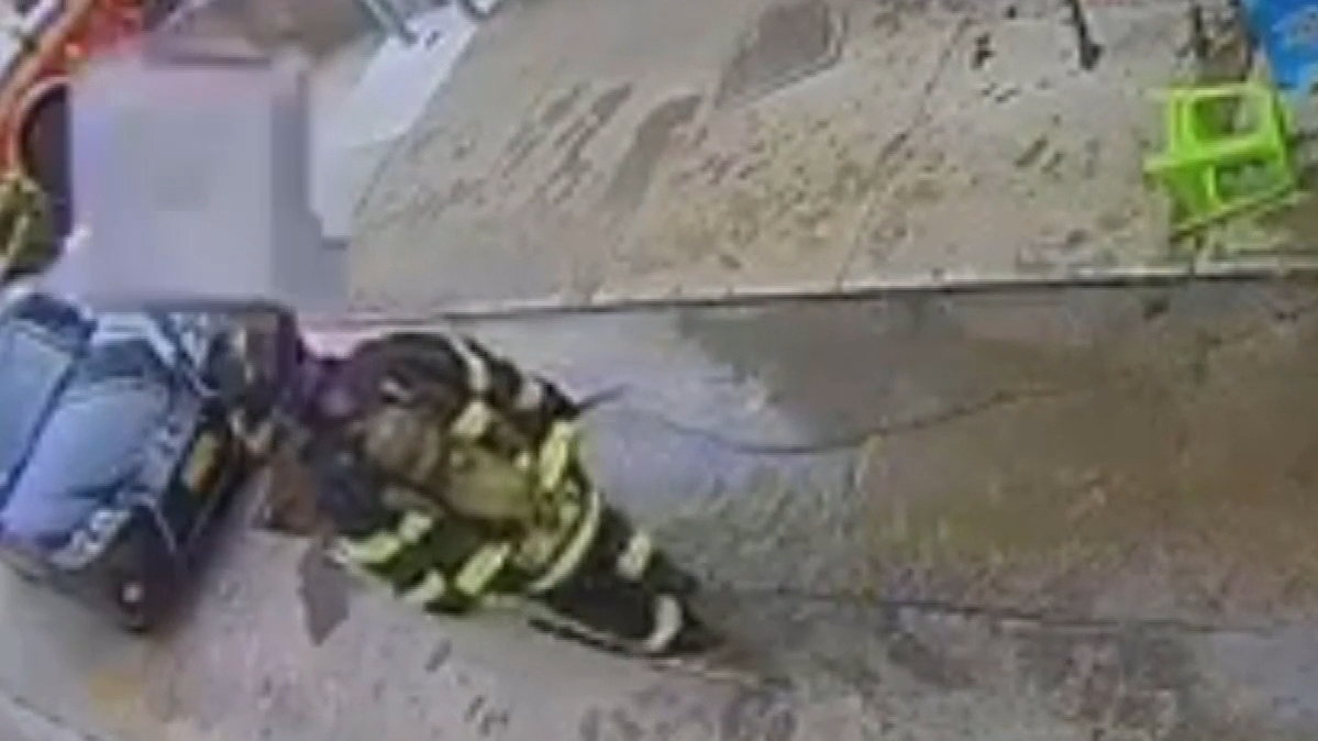 NY firefighter's helmet saves him from falling aircon