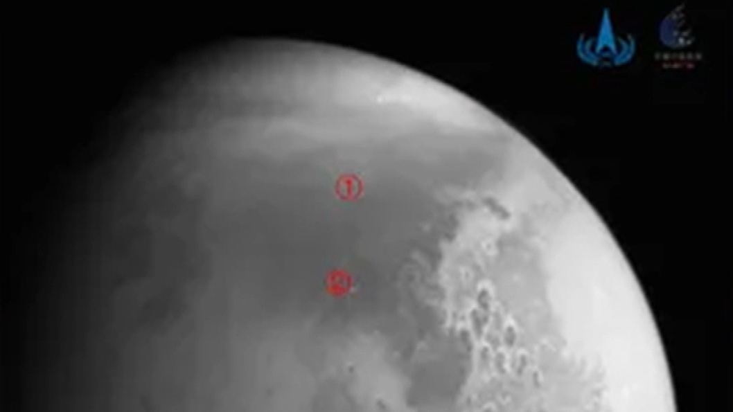 Chinese probe beams back first photos of Mars