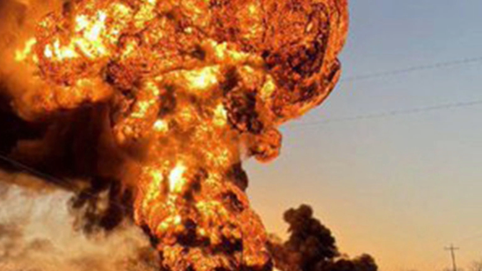 Truck collides with train in Texas, causing large explosion