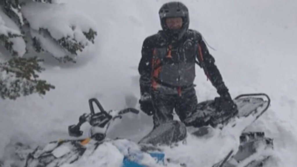 Man survives being pinned beneath snowmobile for hours in the US