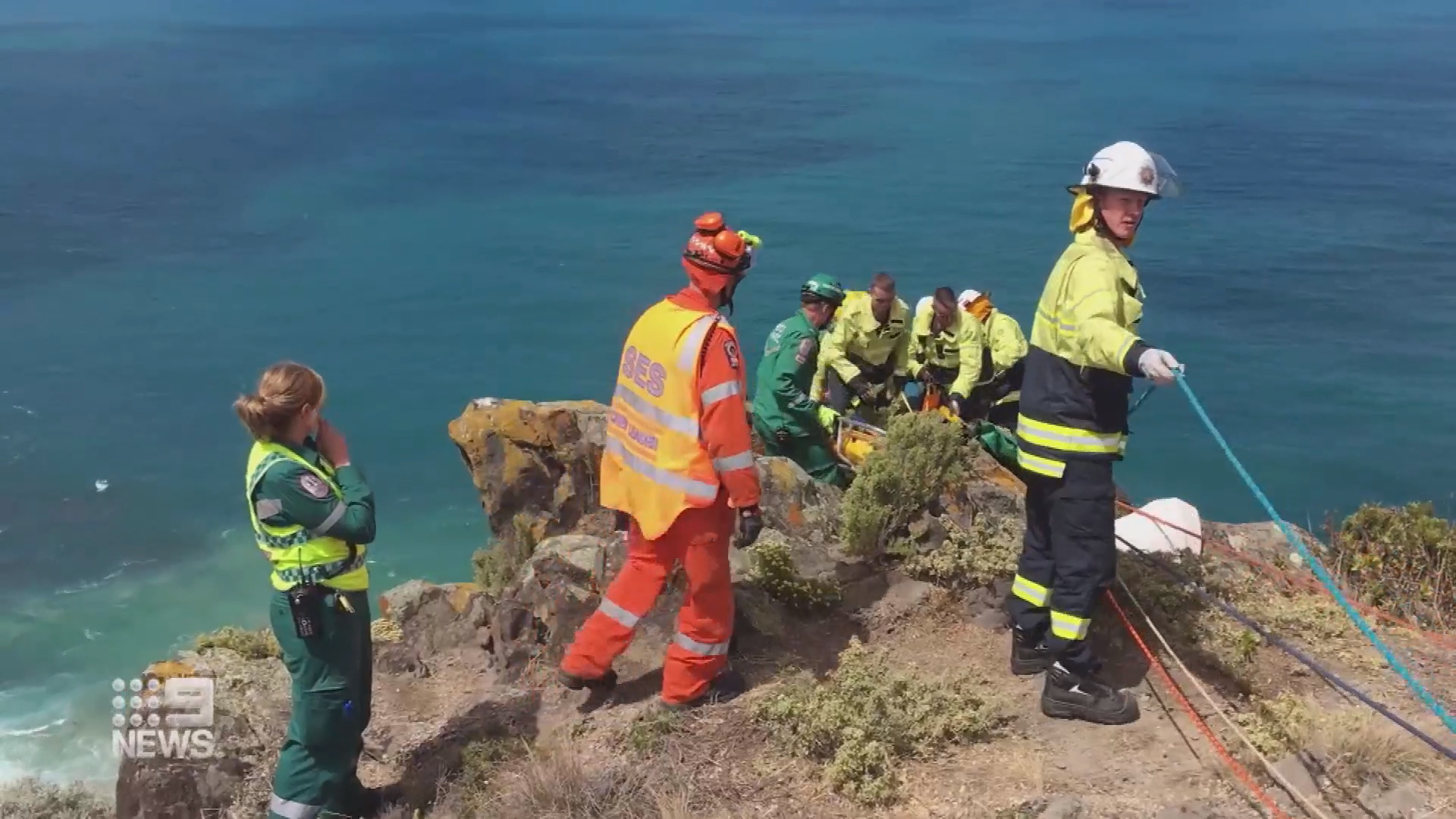 Injured paraglider has been pulled to safety after crashing into a rocky cliff
