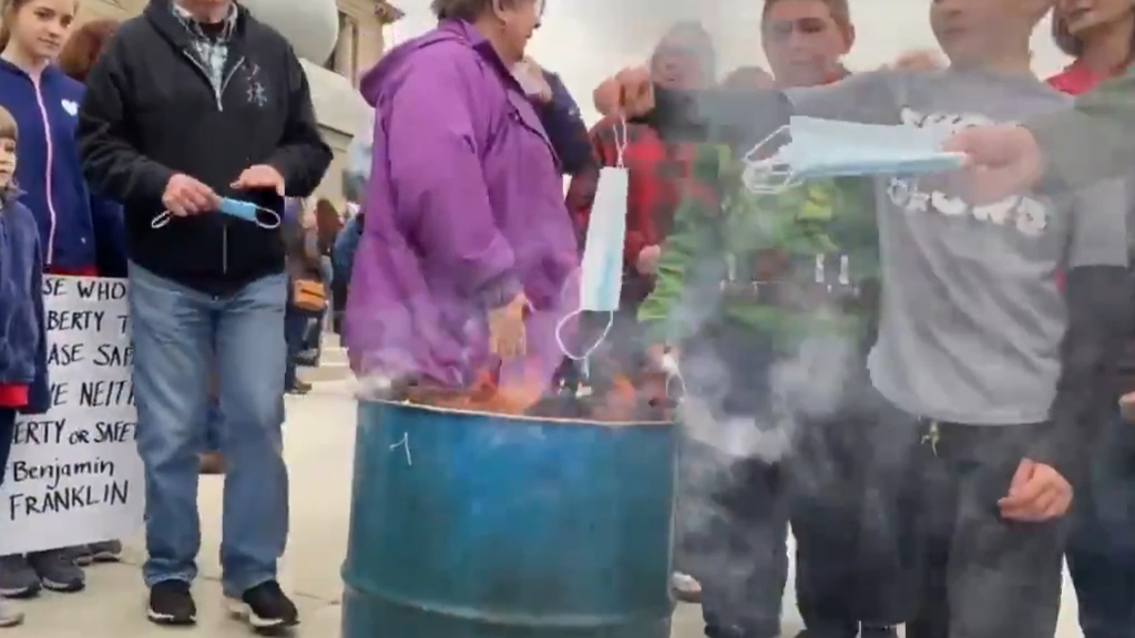 US protesters burn face masks in protest against COVID-19 safety measures