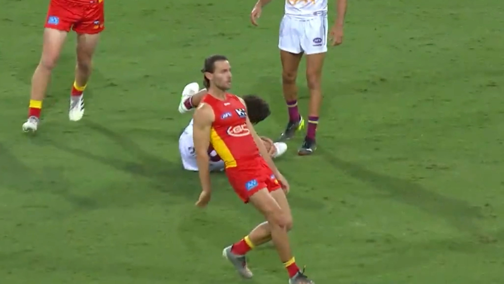 Brisbane's Cam Rayner goes down with a right knee injury