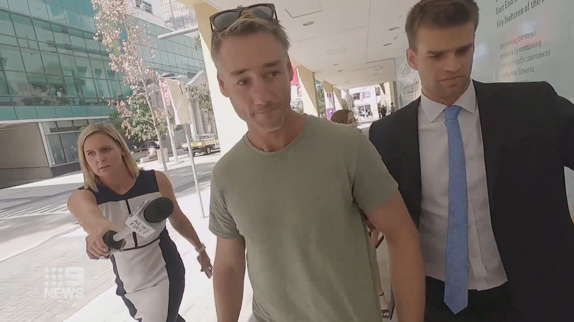 Former AFL player Adam Hunter faces court charged with domestic violence