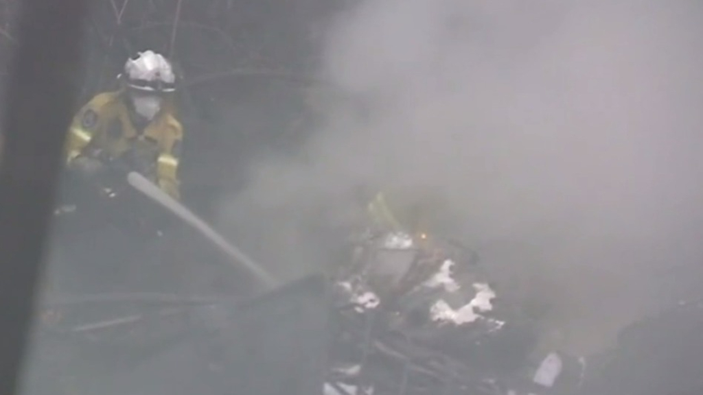 Truck driver rescued from inferno after crash on NSW motorway