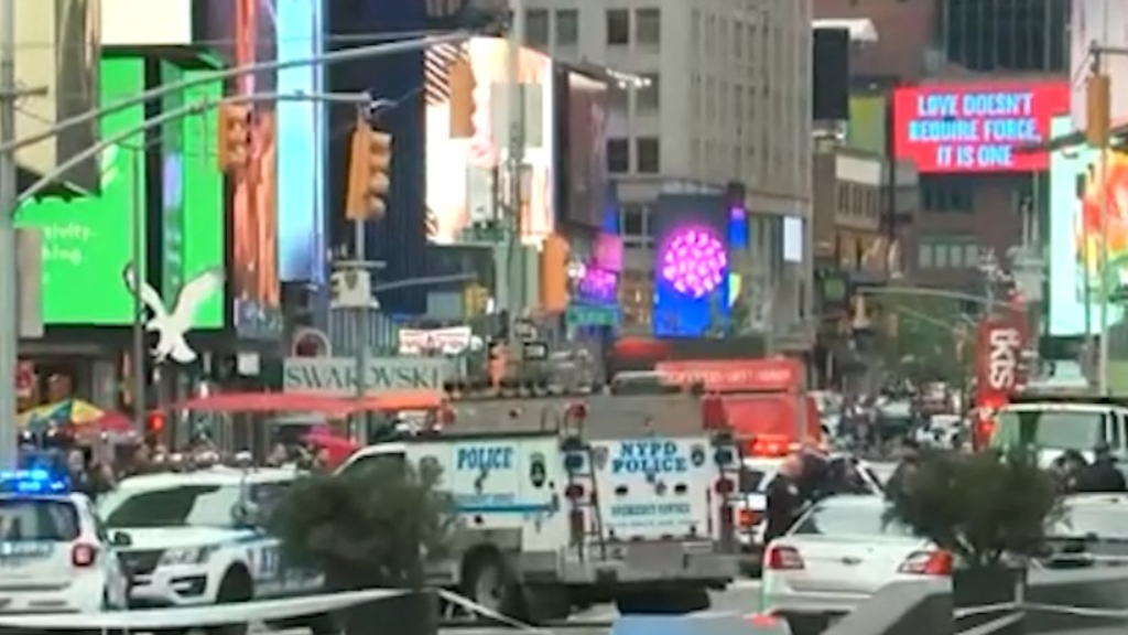 Hunt for gunhunt after three shot in Times Square