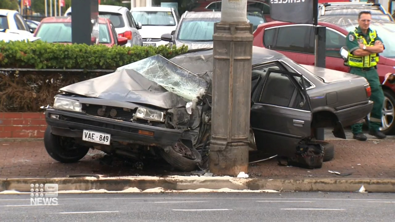 Two men hospitalised after car crash