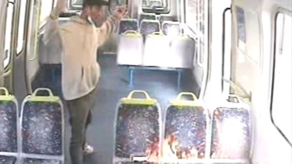 CCTV shows moment man lights Melbourne train seats on fire