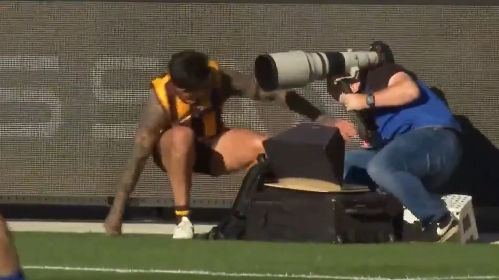 Wingard collides with photographer after kicking a beauty