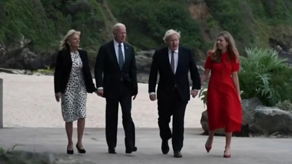 Bidens and Johnsons walk along beach at G7 Summit