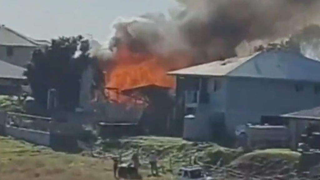 Woman dead, two missing in Queensland house fire