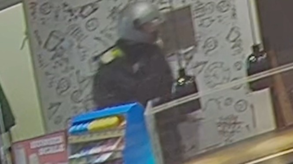 Camera catches gunman committing alleged armed robbery