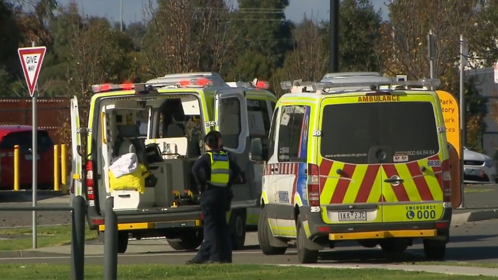 A toddler has been rushed to hospital after falling from a moving car
