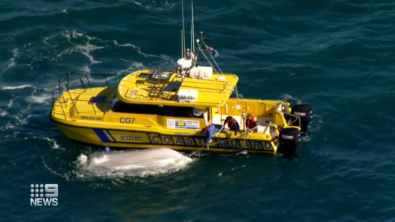 Police have recovered a woman's body from Moreton Bay off Brisbane