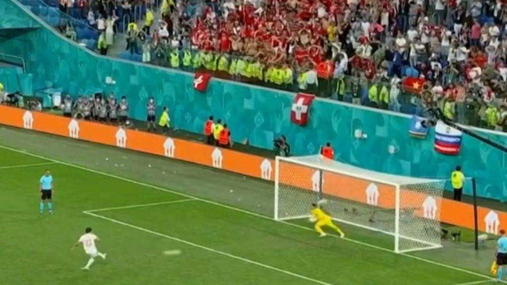 Spain advances in shootout win