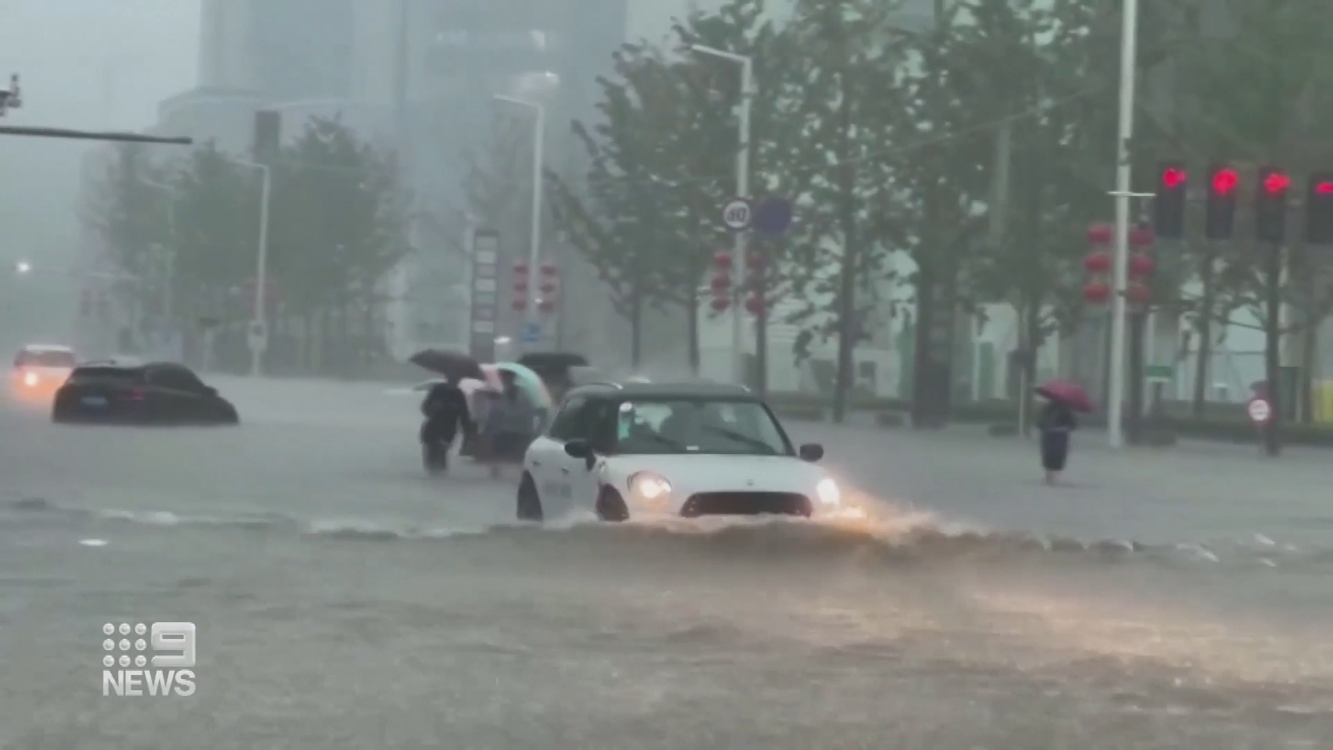 Extreme floodwaters claim at least 12 lives