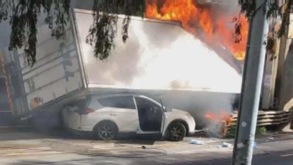 Truck driver escapes fiery crash