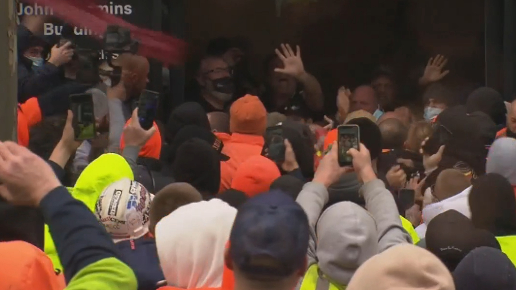 Violent construction protest infiltrated with 'neo-Nazis', fake tradies