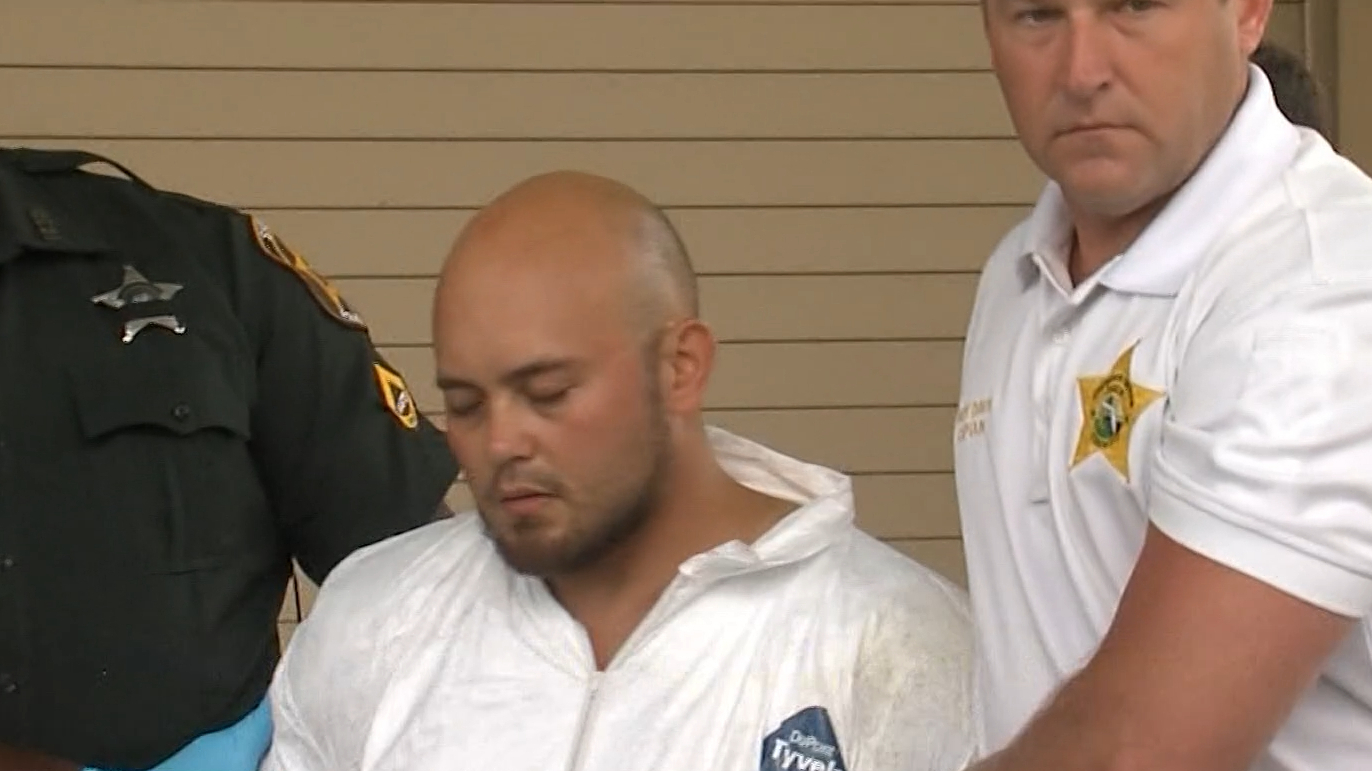 Former US Marine charged with murder of family