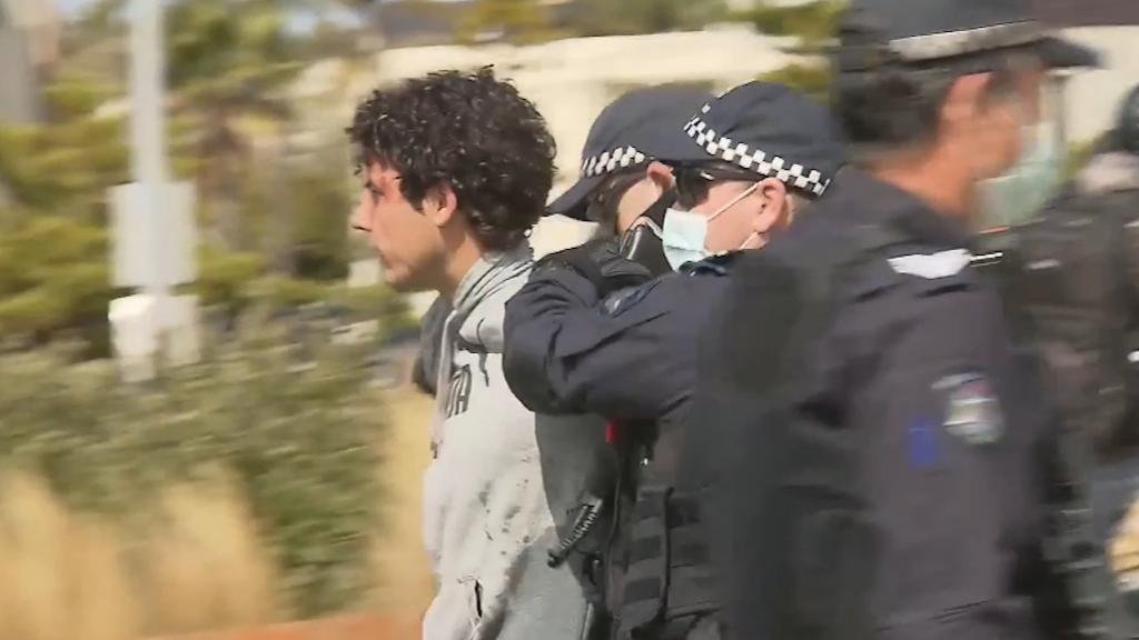 Police arrest protestors at St Kilda foreshore