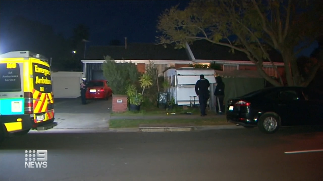 Man stabbed in neck during alleged home invasion in Adelaide's north-east