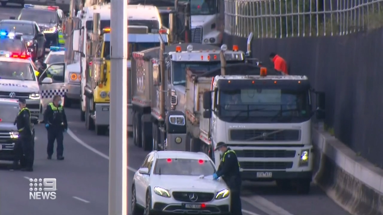 Fines issued after Melbourne truck drivers block freeway in protest action