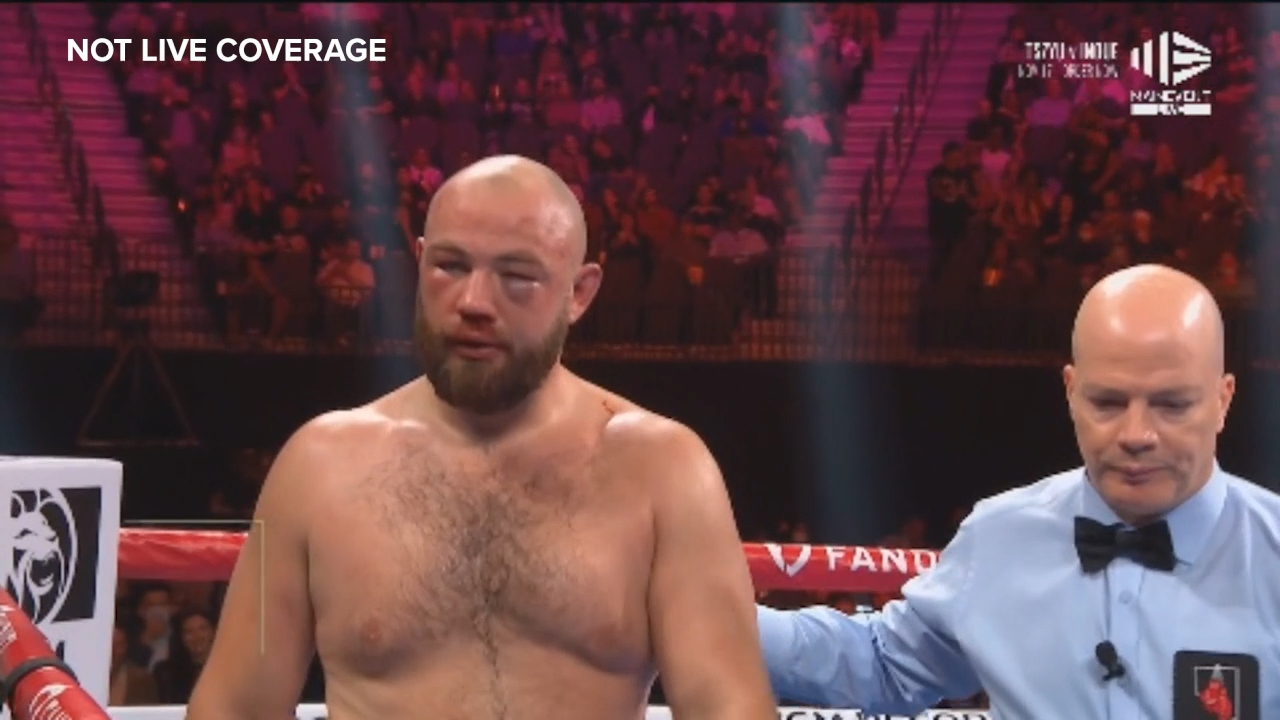 Three low blows forces boxing stoppage