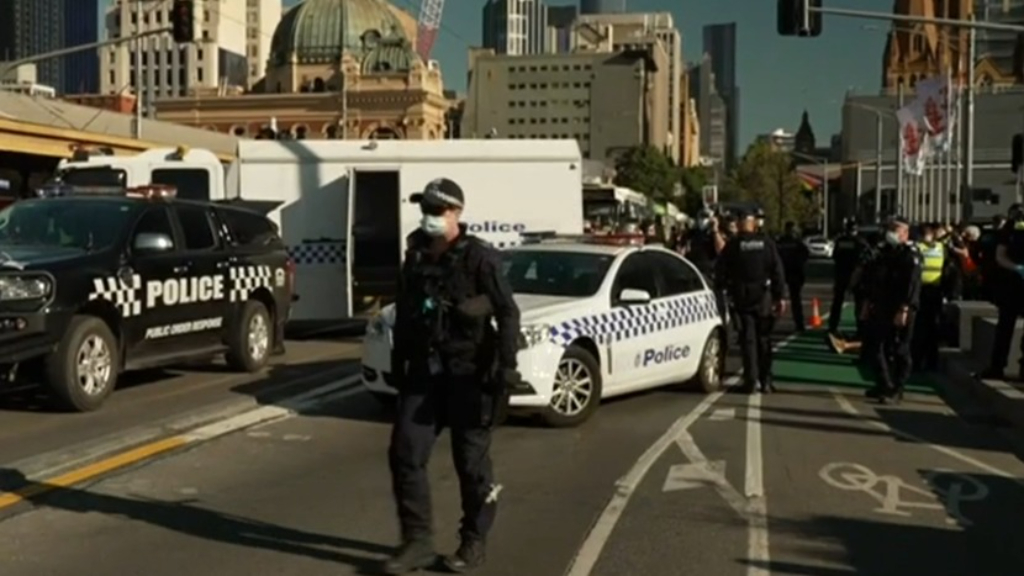 Climate protesters stop traffic on major Melbourne CBD road